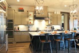 gray kitchen cabinets with black island