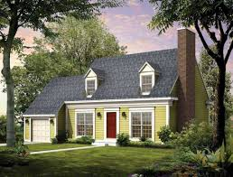 cape cod house style with garage designed with green wall paint