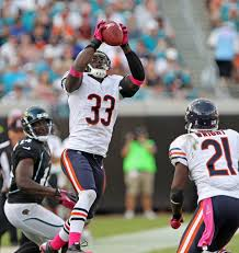 Charles Tillman intercepts a