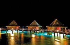 houses bungalows night french polynesia tropical pier lights dark