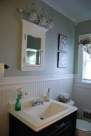 luxury small bathroom remodel presenting beadboard wainscoting