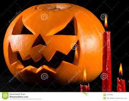 scary pumpkin jack lantern pumpkin halloween red candles on a