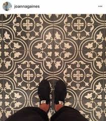 woman covers her bathroom floor with hand drawn tiles