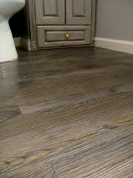 redoing our flooring with peel u0026 stick tile that looks like wood