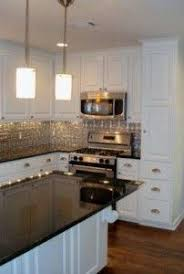 White Cabinets Grey Counter Tin Backsplash Design Pictures - White tin backsplash