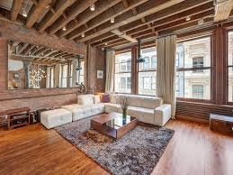 Exposed Beam Ceiling Living Room by Open Plan Apartment With Exposed Wood Beams And Iron Columns