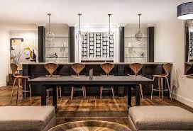 basement black wet bar with glass shelves transitional basement