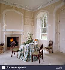 gothic window and gothic plasterwork above fireplace in dining