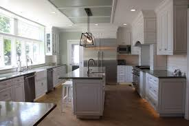 gray kitchen with oak cabinets