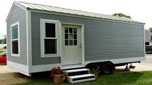 sleek compact tiny home with plenty of storage small home design