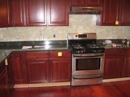 interior kitchen backsplash cherry cabinets black counter
