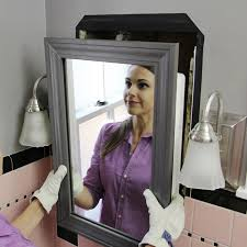 Mirrored Medicine Cabinet Doors by Install A Mirrored Medicine Cabinet And Vanity Light