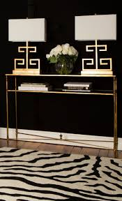 top 25 best zebra print decorations ideas on pinterest zebra i love the brass greek key lamps against the black wall the matching console table that zebra print rug