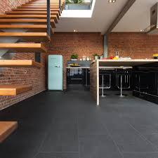 kitchen floor black stone tile vinyl brick wall black cabinets