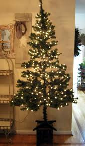 how to fill in ugly bare spots on your christmas tree christmas