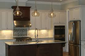 How To Install Kitchen Island by How To Install Tall Oven Cabinets Youtube