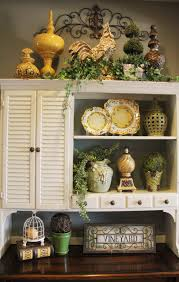 Vintage Decorating Ideas For Kitchens by Above Cabinet Decor Greenery Wrought Iron Scroll The Placement