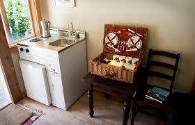 Mini Kitchen Cabinet Picturesque Rattan Cutlery Set Storage Baskets And White Hardwood