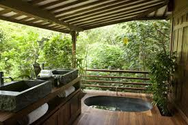 cool outdoor bathroom ideas with round shape white bathtub and