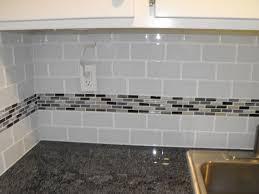 kitchen green glass tile backsplash butcher block countertop