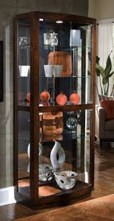 Oak Curio Cabinet Wooden Oak Curio Cabinet In The Corner With Glass Doors Display