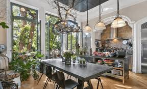 a steel chandelier and french doors to a garden patio in this