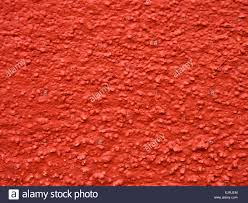 texture of outer wall painted with maroon paint stock photo