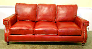 red leather sofa in a white brick wall red sofa red leather sofa