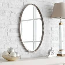 bathroom framed oval bathroom mirror on white brick wall cool