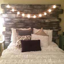 whitewashed rustic headboard made from fenceposts better homes