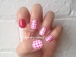 black and white gingham nail art with pink toe nail design