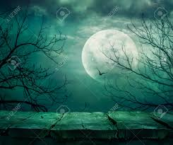 halloween background spooky forest with full moon and wooden