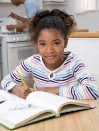 Child doing homework at home    Stock Image