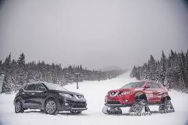 nissan altima coupe in snow nissan rogue warrior tackles ski slopes with snowmobile tracks