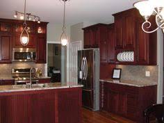Kitchen Backsplash Cherry Cabinets by Medium Brown Cabinets With White Quartz Countertop Google Search