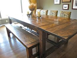 brown reclaimed wood farmhouse dining room table with benches also