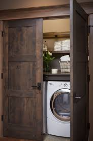 Washer Dryer Cabinet Enclosures by 15 Laundry Spaces That Cleverly Conceal Their Unsightly Appliances