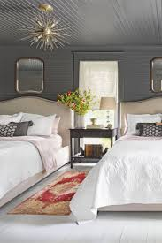 304 best bedroom images on pinterest bedrooms room and guest overhead decor overhead decor a starburst chandelier extra wide nightstand and stacked glass table lamp add a modern edge to this guest room from country