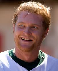 Portrait of Dan Johnson of the Oakland Athletics in the dugout during the game against the Texas Rangers at the McAfee Coliseum in Oakland, California on ... - BMM20027-466x575