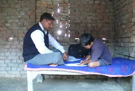 Father helping his son with his homework  India