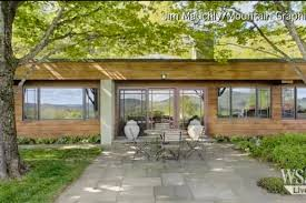 new hampshire earth sheltered home requires mowing the roof but