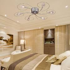 lighting modern bedroom with chandelier ceiling fan and recessed
