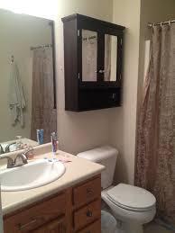 black color small and vintage bathroom cabinet with mirror door