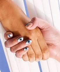 zeta at charles penzone columbus ohio glitter nails evil eye