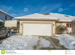 wide garage of big luxury house with parked car and rv trailer