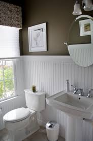 Powder Room In French High Contrast Powder Room Dark Walls White Beadboard Wainscot
