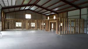 wood framing the inside first floor pole barn garages