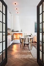 herringbone wood floor steel framed french doors corner