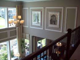 How To Decorate Walls by How To Decorate A Long Wall In The Living Room Using Wall Trim And