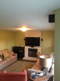 home theater installer tv mounting over a limestone fireplace wall with wires concealed